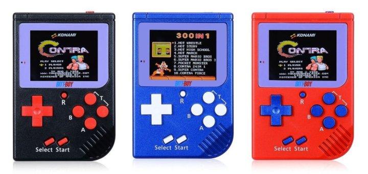 A trio of BittBoy handhelds.